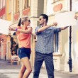 Cute couple with advertise — Stock Photo
