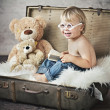Funny picture of little boy in suitcase — Stock Photo