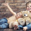 Two happy brothers playing toys — Stock Photo