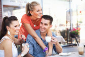 Couple with a friend during lunch — Stock Photo