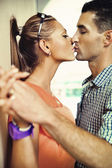 Kissing in romantic scenery — Stock Photo