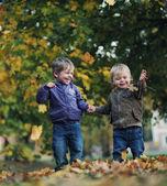 Great fun in autumn parkGreat fun in autumn park — Stock Photo