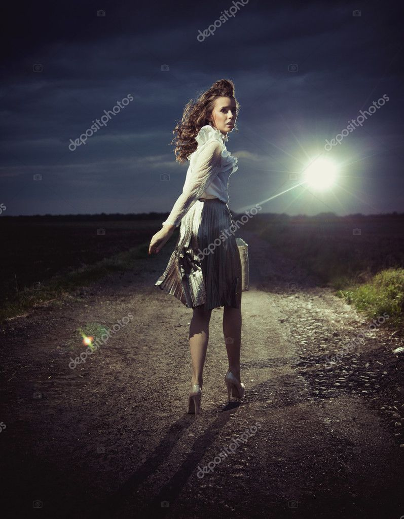 Beautiful woman walking away — Stock Photo #14328985