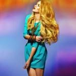 Sensual blonde wearing blue dress — Stock Photo