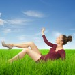 Attractive lady lying on grass — Stock Photo #15686767