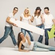 Foto Stock: Group of friends wearing white T-shirts