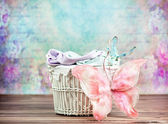 Small wicker basket with colorful background — Stock Photo
