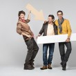 A band of male friends with signs — Stock Photo