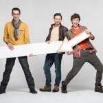 Three man with arrow — Stock Photo