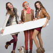 Teenage girls having fun with empty board — Stock Photo