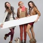 Teenage girls having fun with empty board — Stock Photo