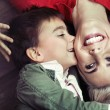 Young boy kissing his mom — Stockfoto