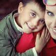 Cute boy smiling with his mom — Stock Photo