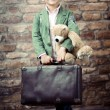 Stylish boy with suitcase — Stock Photo