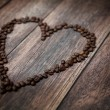 Picture presenting fragrant heart made of coffee beans - Стоковая фотография