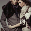 Young couple presenting an autumn fashion — ストック写真