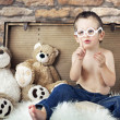 Small cute kid with teddybears — Stock Photo