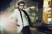 Young fashionable man on the street at night — Stock Photo