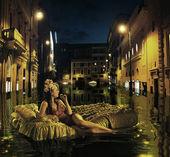 Stylish lady drifting among antique buildings — Stock Photo