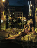 Alone lady watching flooded city — Stock Photo