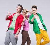 Three friends in optimistic pose — Stock Photo