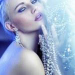 Stunning blonde beautiful woman with jewelary — Stock Photo #22276935