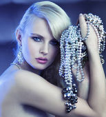 Fabulous woman with bouquet of jewelary — Stock Photo