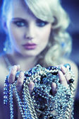 Amazing blonde woman with jewelary — Stock Photo