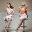 Two young ladies taking care of their hair — Stock Photo