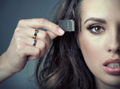Sensual woman inserting card into her head — Stock Photo