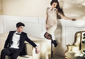 Young handsome guy with his girlfriend in luxury room — Stok fotoğraf
