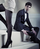 Young handsome man looking at sexy legs — Stock Photo