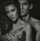 Blac-white portrait of sensual couple — Stock Photo