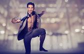 Handsome muscular man in loose suit — ストック写真