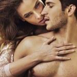 Sensual woman touching her boyfriend's perfect body — Stock Photo