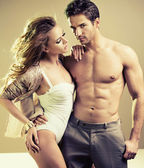 Lucky young lady with perfect male body — Stock Photo