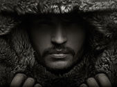 Portrait of a young man in fur hood — Stok fotoğraf