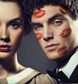 Handsome man with kiss-signs on the face — Stock Photo