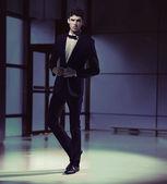 Handosme slim guy wearing black suit — Stock Photo