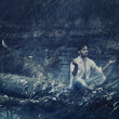 Art photo of handsome man meditating in the rain - Stock fotografie