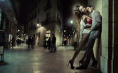 Sensual loving couple kissing in the dead of the night — Stock Photo