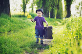 Little gentleman with huge suitcase — Stock Photo