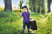 Young boy with huge suitcase — Stock Photo