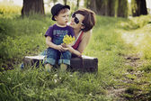 Nice picture of mother and son on the meadow — Stock Photo