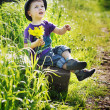 Little man with bouquet of flowers — Stockfoto
