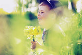 Cheerful child playing on the meadow — Stock Photo