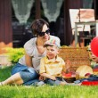 Photo presenting happy family in the garden — Stock Photo