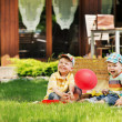 Two cute kids playing in the garden — 图库照片
