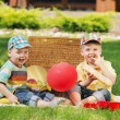 Two little brothers playing on the balnket — Stock Photo