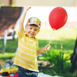 Smiling boy with red baloon — Stock Photo